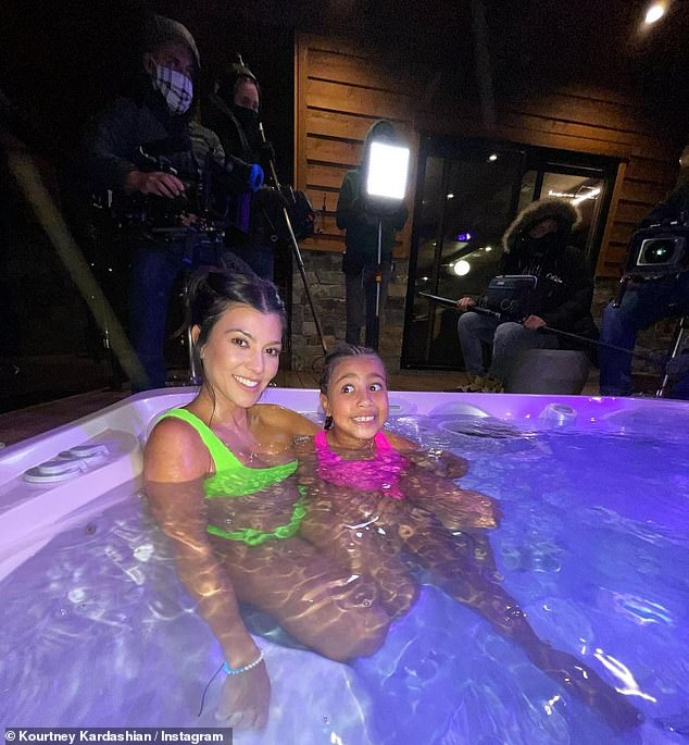 Legit Girls: The reality star, 41, smiled as she sat in the hot tub in a neon green bikini, while her northern niece wore a pink one-piece