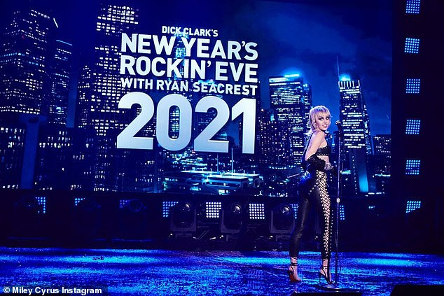 Wow factor: Miley Cyrus slipped into a revealing leather set for a voice check prior to her big performance in Rockin 'Eve for New Year's Dick Clark with Ryan Seacrest on Thursday
