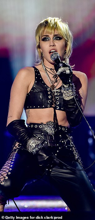 Another leather look saw Miley sport biker elegance in a combination of a bra, leather, and pants