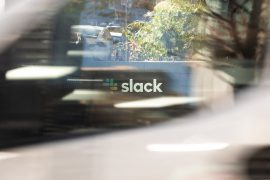 The Slack logo is seen through the window of a passing vehicle outside its headquarters on December 1, 2020 in San Francisco, California