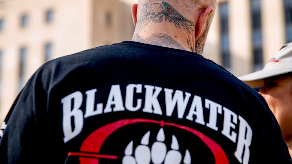A Blackwater employee tattooed in front of a court in Washington where he accused four of his colleagues of committing a massacre of civilians in Baghdad.  When their sentences fell in 2014, Eric Prince changed the name of the company and later sold it.