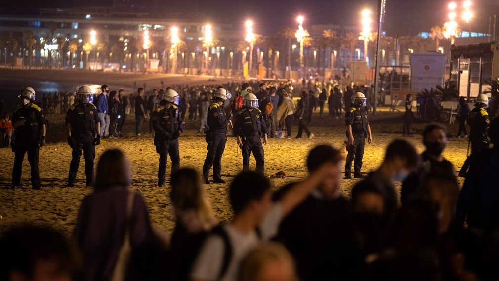 Police on the beach in Barcelona.